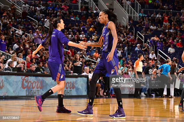 DeWanna Bonner and Sonja Petrovic of the Phoenix Mercury high five each other during the game against the New York Liberty on July 1 2016 at US...
