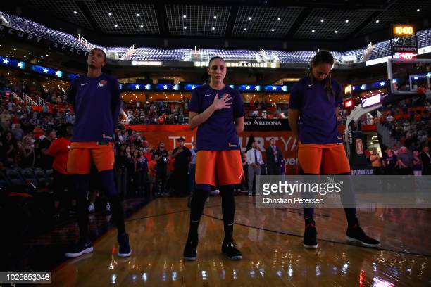 DeWanna Bonner Diana Taurasi and Brittney Griner of the Phoenix Mercury stand attended for the national anthem before game three of the WNBA Western...