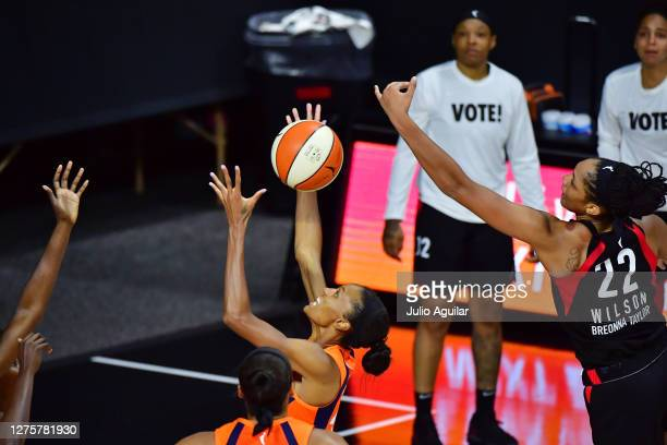 DeWanna Bonner of the Connecticut Sun grabs a defensive rebound over A'ja Wilson of the Las Vegas Aces during the second half of Game 2 of their...