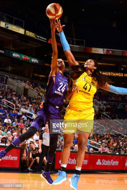 DeWanna Bonner of the Phoenix Mercury and Alaina Coates of the Chicago Sky reach for the ball on July 25 2018 at Talking Stick Resort Arena in...