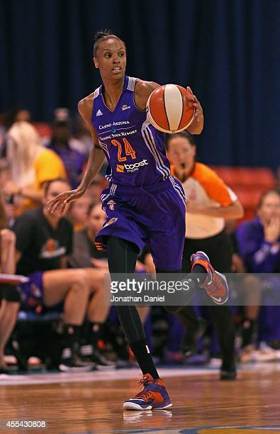 DeWanna Bonner of the Phoenix Mercury brings the ball up the court against the Chicago Sky during game three of the WNBA Finals at the UIC Pavilion...