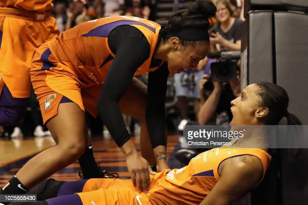 DeWanna Bonner of the Phoenix Mercury celebrates with Briann January after scoring against the Seattle Storm during game three of the WNBA Western...