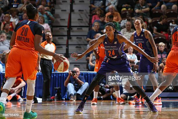 DeWanna Bonner of the Phoenix Mercury defends against Alex Bentley of the Connecticut Sun during a WNBA game on September 2 2016 at the Mohegan Sun...
