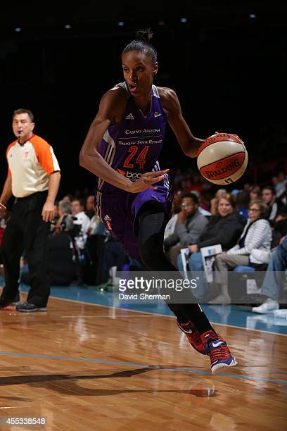 DeWanna Bonner of the Phoenix Mercury dribbles against the Chicago Sky in Game Three of the 2014 WNBA Finals on September 12 2014 at the UIC Pavilion...