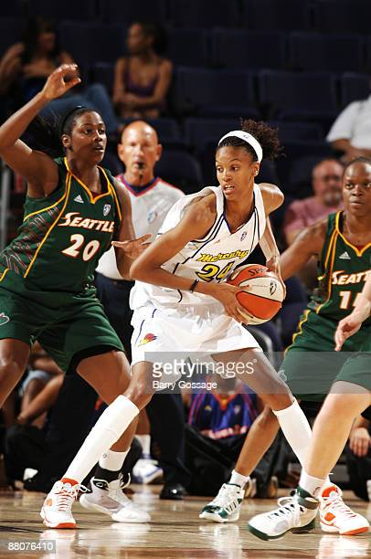 DeWanna Bonner of the Phoenix Mercury drives against Camille Little of the Seattle Storm in an WNBA game played on May 30 2009 at US Airways Center...