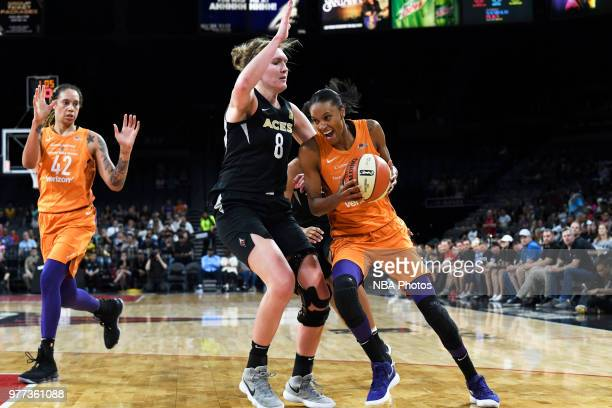 DeWanna Bonner of the Phoenix Mercury drives against Carolyn Swords of the Las Vegas Aces on June 17 2018 at the Mandalay Bay Events Center in Las...