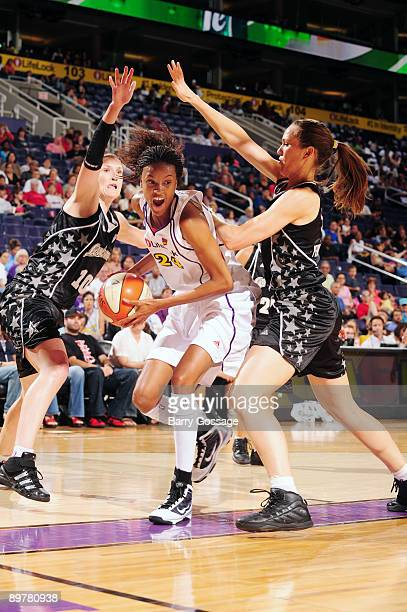 DeWanna Bonner of the Phoenix Mercury drives against Erin Perperoglou and Belinda Snell of the San Antonio Silver Stars in a WNBA at US Airways...