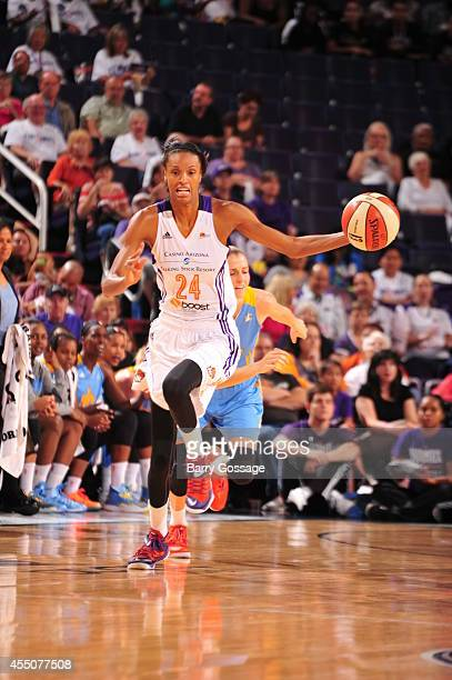 DeWanna Bonner of the Phoenix Mercury drives to the basket against the Chicago Sky in Game 2 of the 2014 WNBA Finals on September 9 2014 at US...