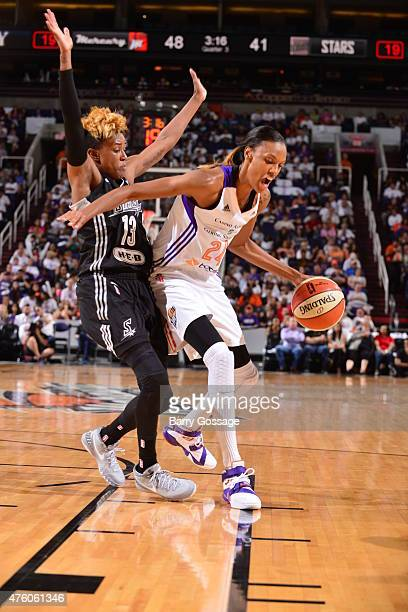 DeWanna Bonner of the Phoenix Mercury drives to the basket against Danielle Robinson of the San Antonio Stars on June 5 2015 at the Talking Stick...