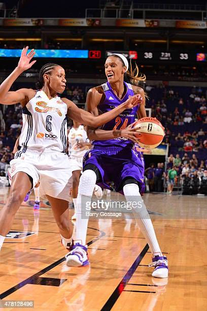 DeWanna Bonner of the Phoenix Mercury drives to the basket against Jasmine Thomas of the Connecticut Sun on June 19 2015 at the Talking Stick Resort...