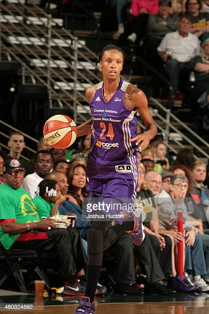 DeWanna Bonner of the Phoenix Mercury drives to the basket against the Seattle Storm during the game on June 25 2015 at KeyArena in Seattle...