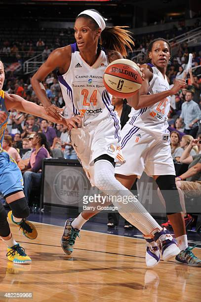 DeWanna Bonner of the Phoenix Mercury drives to the basket against the Chicago Sky on July 27 2015 at Talking Stick Resort Arena in Phoenix Arizona...