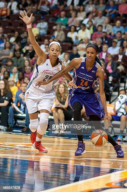 DeWanna Bonner of the Phoenix Mercury drives to the basket against Jennifer Lacy of the Connecticut Sun on August 27 2015 at the Mohegan Sun Arena in...