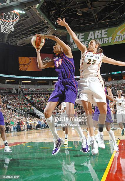 DeWanna Bonner of the Phoenix Mercury goes to the basket against Svetlana Abrosimova of the Seattle Storm in Game One of the 2010 Western Conference...