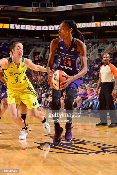 DeWanna Bonner of the Phoenix Mercury handles the ball against Jenna O'Hea of the Seattle Storm on September 15 2016 at Talking Stick Resort Arena in...