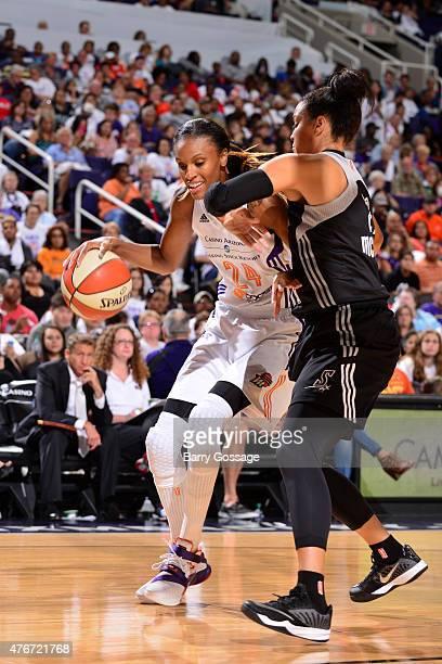 DeWanna Bonner of the Phoenix Mercury handles the ball against the San Antonio Spurs on June 5 2015 at Talking Stick Resort Arena in Phoenix Arizona...