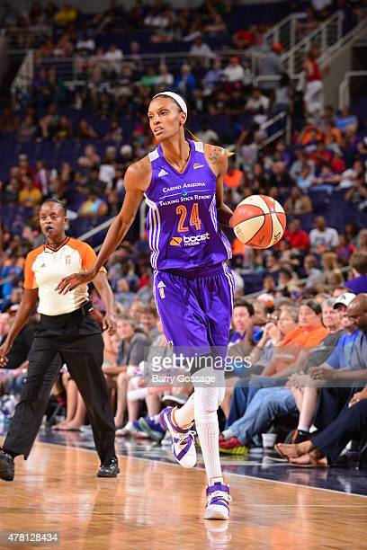 DeWanna Bonner of the Phoenix Mercury handles the ball against the Connecticut Sun on June 19 2015 at the Talking Stick Resort Arena in Phoenix...