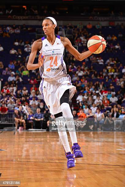 DeWanna Bonner of the Phoenix Mercury handles the ball against the San Antonio Stars on June 30 2015 at Talking Stick Resort Arena in Phoenix Arizona...