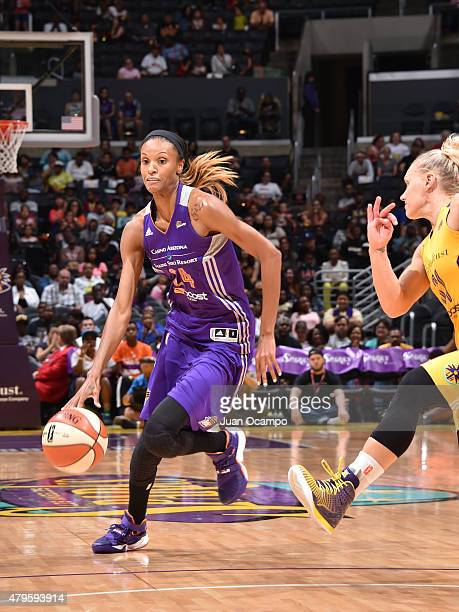 DeWanna Bonner of the Phoenix Mercury handles the ball against the Los Angeles Sparks at Staples Center on July 2 2015 in Los Angeles California NOTE...
