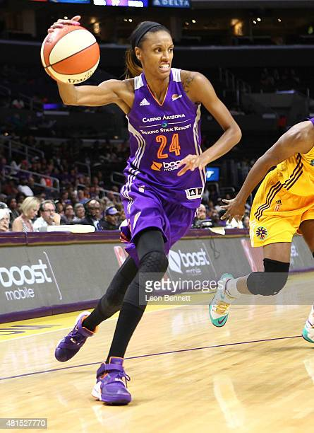 DeWanna Bonner of the Phoenix Mercury handles the ball against the Los Angeles Sparks in a WNBA game at Staples Center on July 21 2015 in Los Angeles...