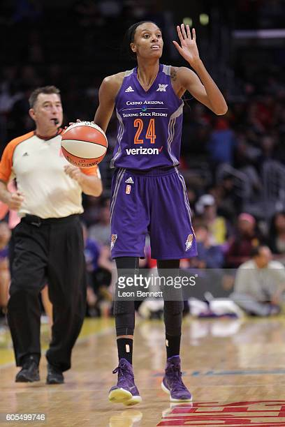 DeWanna Bonner of the Phoenix Mercury handles the ball against the Los Angeles Sparks during a WNBA basketball game at Staples Center on September 13...