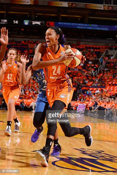 DeWanna Bonner of the Phoenix Mercury handles the ball against the Minnesota Lynx in Game Three of the Semifinals during the 2016 WNBA Playoffs on...