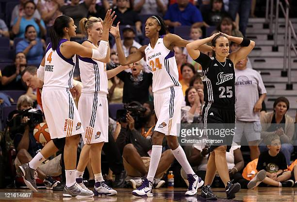 DeWanna Bonner of the Phoenix Mercury high-fives Candice Dupree and Penny Taylor after scoring past Becky Hammon of the San Antonio Silver Stars...