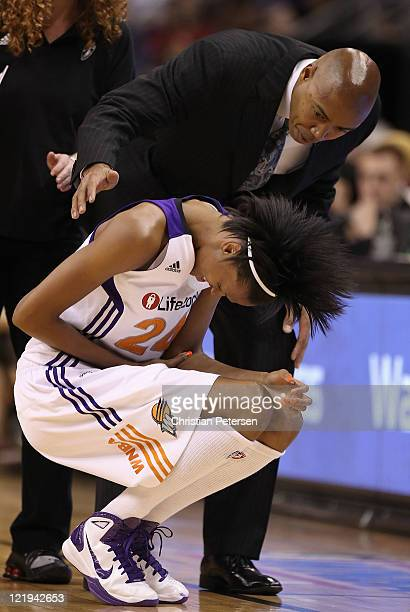 DeWanna Bonner of the Phoenix Mercury reacts to head coach Corey Gaines after injuring her elbow during the WNBA game against the New York Liberty at...