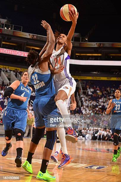 DeWanna Bonner of the Phoenix Mercury shoots against Rebekkah Brunson of the Minnesota Lynx in Game 2 of the Western Conference Finals during 2013...