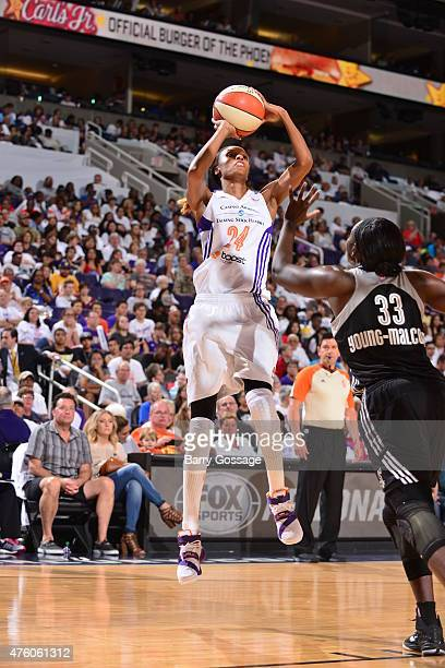 DeWanna Bonner of the Phoenix Mercury shoots against Sophia YoungMalcolm of the San Antonio Stars on June 5 2015 at the Talking Stick Resort Arena in...