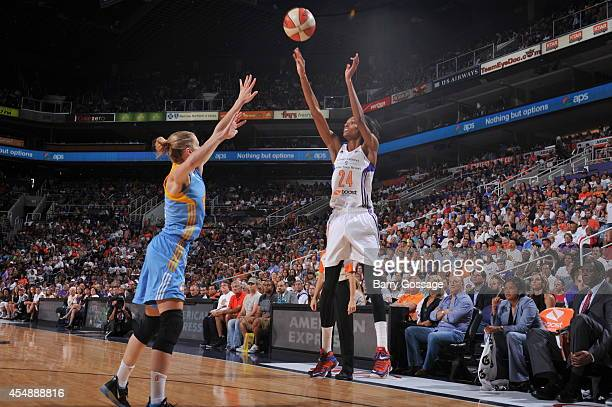 DeWanna Bonner of the Phoenix Mercury shoots against the ball against Allie Quigley of the Chicago Sky in Game 1 of the 2014 WNBA Finals on September...