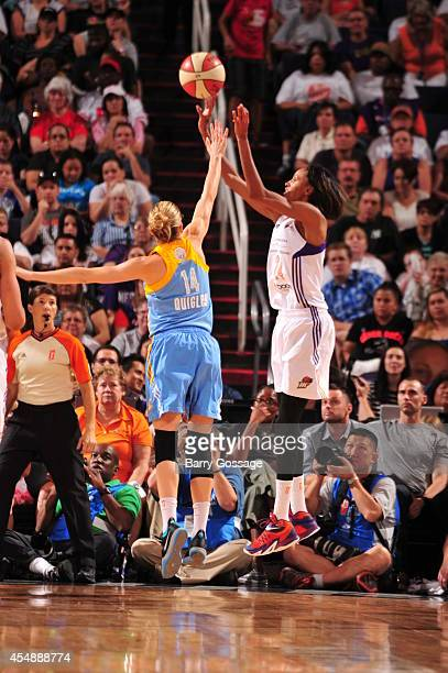 DeWanna Bonner of the Phoenix Mercury shoots the ball against Allie Quigley of the Chicago Sky in Game 1 of the 2014 WNBA Finals on September 7 2014...