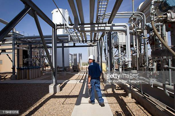 Deward Cawthon plant operator at the Federal Helium Reserve walks through the Federal Crude Helium Enrichment Unit near Amarillo Texas on Wednesday...