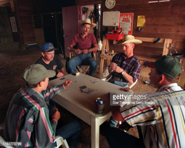 DeWayne Bellander left Dan Knigge Merlin Anderson Vic Hanson and Warren Kelly relax with a card game at the end of a work day on the backside of...