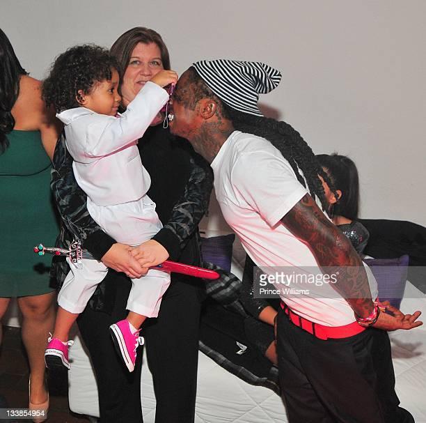 Dewayne Carter III and Dewayne 'Lil Wayne' Carter attend Reginae Carter's 13th Birthday party at The Callanwolde Mansion on November 19 2011 in...