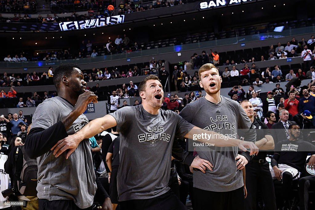 Dewayne Dedmon #3, David Lee #10 and Davis Bertans #42 of the San Antonio Spurs react to a play in warm ups before the game against the Phoenix Suns as part of NBA Global Games at Arena Ciudad de Mexico on January 14, 2017 in Mexico City, Mexico.