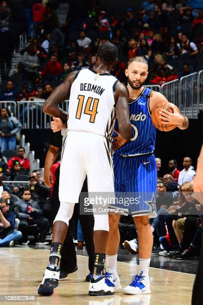 Dewayne Dedmon of the Atlanta Hawks and Evan Fournier of the Orlando Magic exchange a hug after the game on January 21 2019 at State Farm Arena in...