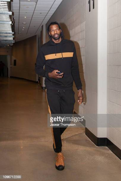 Dewayne Dedmon of the Atlanta Hawks arrives before the game against the Charlotte Hornets on February 9 2019 at State Farm Arena in Atlanta Georgia...