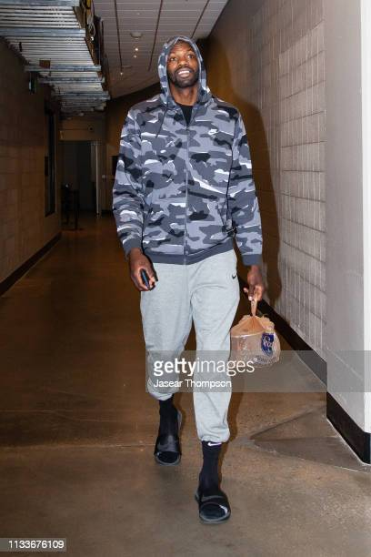 Dewayne Dedmon of the Atlanta Hawks arrives before the game against the Portland Trail Blazers on March 29 2019 at State Farm Arena in Atlanta...