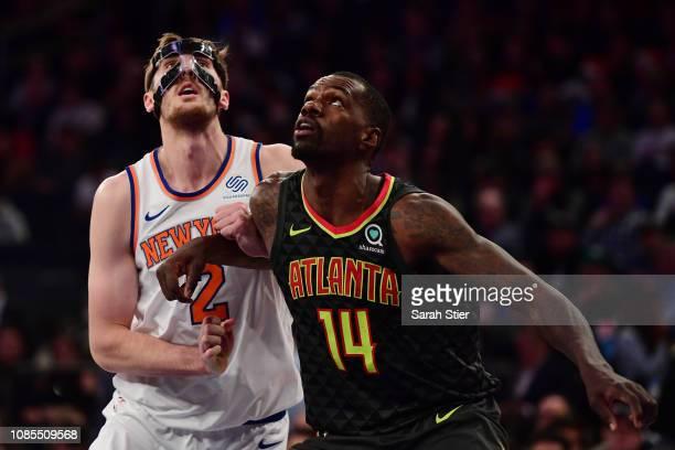 Dewayne Dedmon of the Atlanta Hawks guards Luke Kornet of the New York Knicks during the third quarter of the game at Madison Square Garden on...