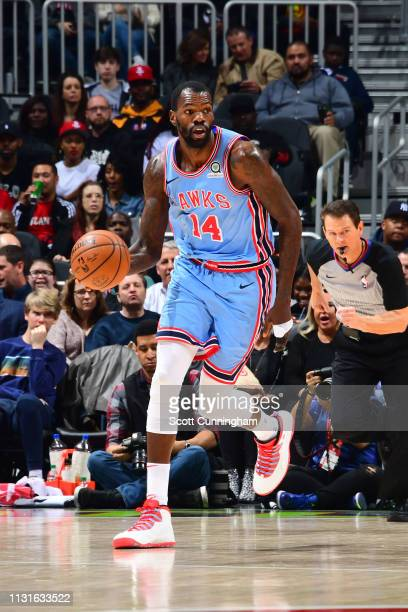 Dewayne Dedmon of the Atlanta Hawks handles the ball against the Houston Rockets on March 19 2019 at State Farm Arena in Atlanta Georgia NOTE TO USER...