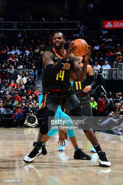 Dewayne Dedmon of the Atlanta Hawks handles the ball against the Charlotte Hornets on March 9 2020 at State Farm Arena in Atlanta Georgia NOTE TO...