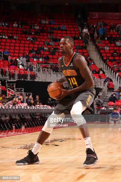 Dewayne Dedmon of the Atlanta Hawks handles the ball against the Detroit Pistons on October 6 2017 at Little Caesars Arena in Detroit Michigan NOTE...