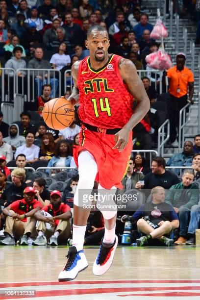 Dewayne Dedmon of the Atlanta Hawks handles the ball during the game against the Toronto Raptors on November 21 2018 at the State Farm Arena in...