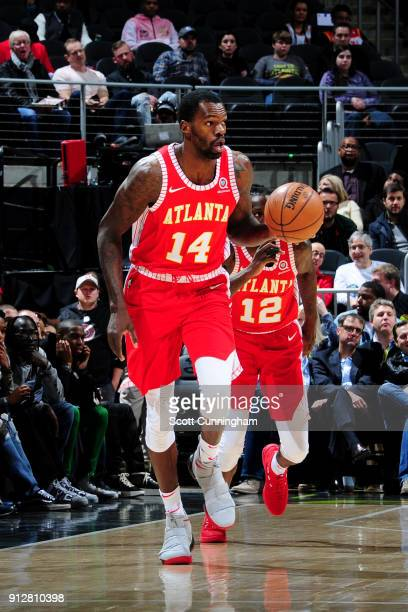 Dewayne Dedmon of the Atlanta Hawks handles the ball during the game against the Charlotte Hornets on January 31 2018 at Philips Arena in Atlanta...