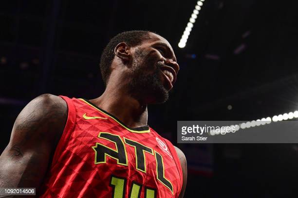 Dewayne Dedmon of the Atlanta Hawks looks on during a timeout in the third quarter of the game against the Brooklyn Nets at Barclays Center on...