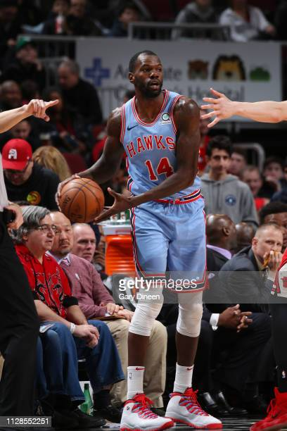 Dewayne Dedmon of the Atlanta Hawks looks to pass the ball during the game against the Chicago Bulls on March 3 2019 at the United Center in Chicago...