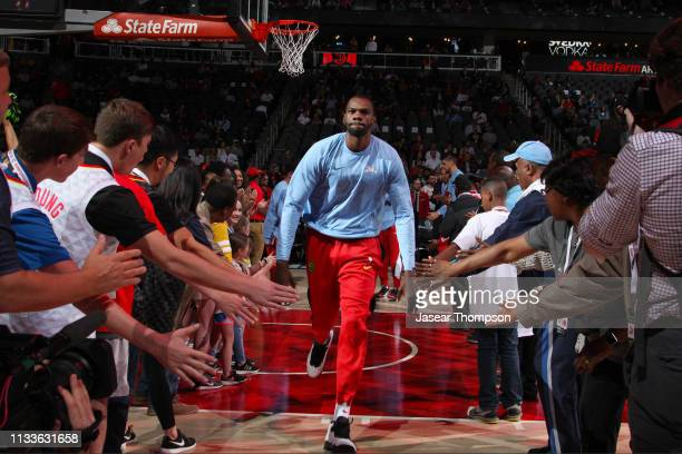 Dewayne Dedmon of the Atlanta Hawks makes his entrance before the game against the Portland Trail Blazers on March 29 2019 at State Farm Arena in...