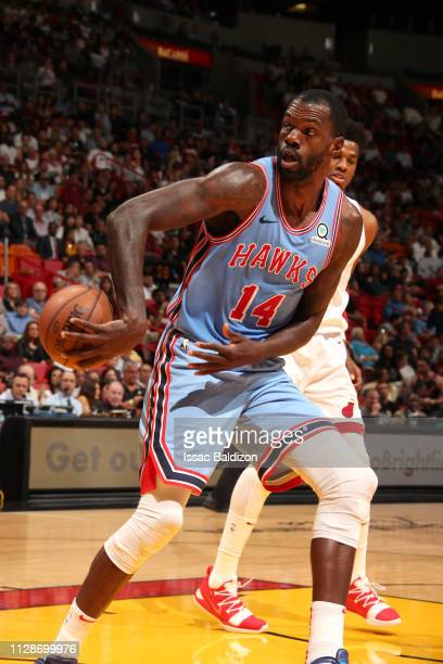 Dewayne Dedmon of the Atlanta Hawks passes the ball behind back against the Miami Heat on March 4 2019 at American Airlines Arena in Miami Florida...
