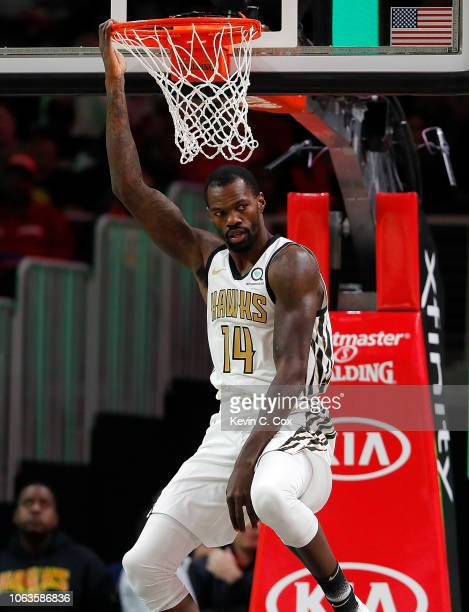 Dewayne Dedmon of the Atlanta Hawks reacts after dunking against the LA Clippers at State Farm Arena on November 19 2018 in Atlanta Georgia NOTE TO...